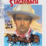 USA - CIRCA 1978 : stamp printed in USA shows poster with John W