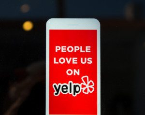 LOS ANGELES, CA/USA - November 11, 2015: Yelp emblem on restaurant exterior. Yelp publishes on-line reviews about businesses.