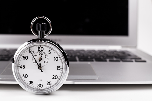 stopwatch checking website speed on laptop computer