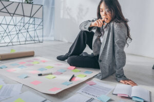 woman on floor thinking about master business plan
