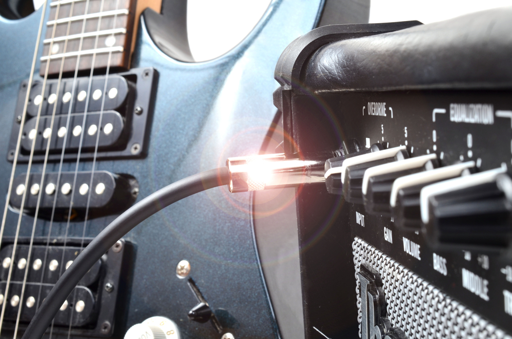 power amplifier and electric guitar dentist blog post